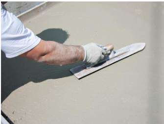Picture of man smoothing concrete